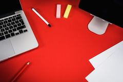 View of the red desk with a computer Royalty Free Stock Image
