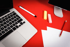 View of the red desk with a computer Royalty Free Stock Photos