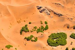 View of red dunes and grasses of the Sossusvlei Namib des. Aerial view of red dunes and grasses of the Sossusvlei Namib desert in Namibia stock photography