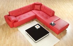 A view of a red leather sofa Stock Image
