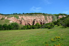 View of the Red Ravine (Rapa Rosie) from Romania, a unique phenomenon in Europe. Rapa Rosie is located just 3 km from the town of Sebes, Romania, Europe on the Stock Photography