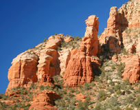 A View of Red Rocks, Blue Sky, and Green Trees Stock Images