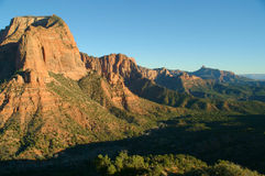 View of red rocks and landscape in Zions National Park. View from the road in Zions' National Park, Kolob Canyon side, during the wintertime Stock Photos