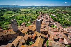 View of the red roofs and green valley in San Gimignano Royalty Free Stock Photography
