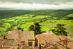 View of the red roofs and green valley in Volterra Royalty Free Stock Images
