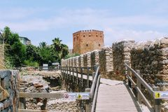View of Red Tower and fortress wall from the old shipyard Alanya, Turkey Royalty Free Stock Photos