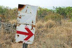 SIGNPOSTS WITH ARROWS ON A HIKING TRAIL. View of red and white signs posted on a hiking trail to indicate direction stock photos