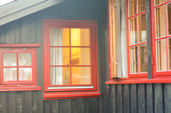 View through red window into a house Royalty Free Stock Photo