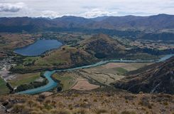 A view from the Remarkables at the landscape with the Kawarau River near Queenstown in New Zealand. A view from the Remarkables at the landscape with the Kawarau stock photos