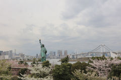 View replica of statue of liberty with Rainbow Bridge Royalty Free Stock Images