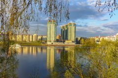 View of the residential area of St. Petersburg Rybatskoye from the opposite Bank. Of the Neva river stock photography