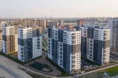 View of the residential area of St. Petersburg at sunrise, modern buildings, Parking, cars, new building.  royalty free stock photos