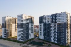 View of the residential area of St. Petersburg at sunrise, modern buildings, Parking, cars, new building.  stock photos