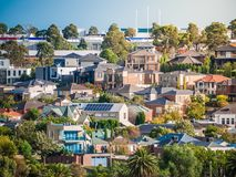 View of residential houses in Melbourne`s suburb on a hill. City of Maribyrnong, VIC Australia. Suburban houses on hill in City of Maribyrnong. Concept of real royalty free stock photos