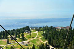 View of the resort area at Grouse Mountain seen from a chair lift Stock Images