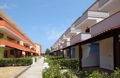 View of resort on coast. orange-storey villas Stock Photography