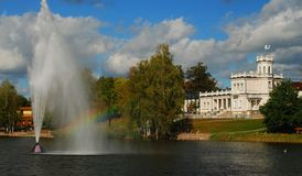 View of resort Druskininkai. Lithuania, Druskininkai. view of the city museum from the lake Druskonis on a sunny day and rainbow in fountain stock photo