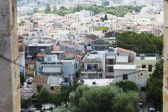 View of resort Greek architecture Rethymno city-port, built by Venetians, from height of Fortezza Castle - fortress on hill Paleok. Astro. Red tiled roofs and Royalty Free Stock Image