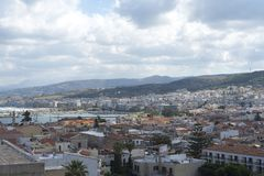 View of resort Greek architecture Rethymno city-port, built by Venetians, from height of Fortezza Castle - fortress on hill Paleok. Astro. Red tiled roofs and Stock Photography