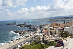 View of resort Greek architecture Rethymno city-port, built by Venetians, from height of Fortezza Castle - fortress on hill Paleok. Astro. Red tiled roofs and Royalty Free Stock Photo