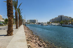 View on resort hotels of Eilat, Israel. View on promenade, marine,moored yachts and resort hotels of Eilat Royalty Free Stock Images
