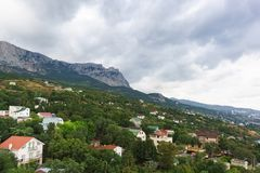 View of the resort village of Alupka and AI-Petri mountain on a. Cloudy day. Crimea, Russia royalty free stock photography