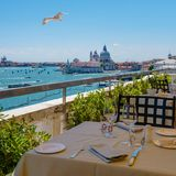 View from the restaurant on the cityscape of Venice and Grand Canal with Santa Maria della Salute church. Stock Photo