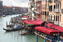 View of restaurants and gondolas on Grand Canal in Venice Royalty Free Stock Photography