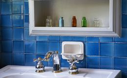 The view of the restroom. On a wall of a blue tile Royalty Free Stock Photography