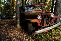 Abandoned Willys Jeep Station Wagon - Junkyard - Pennsylvania. A view of a retro, vintage Willys Jeep Station Wagon in a junkyard in Pennsylvania royalty free stock photos
