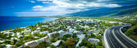 View of Reunion Island. A scenic view of the French commune of Saint-Paul between the Tamarins freeway and the coastline on Reunion Island stock image