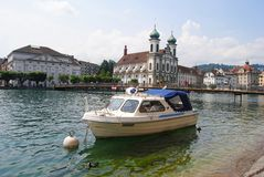 View of the Reuss River and Jesuitenkirche in Lucerne. Royalty Free Stock Photos