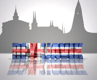 View of Reykjavik. Word Reykjavik with national flag of Iceland near skyline silhouette Royalty Free Stock Photography