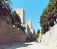 Rhodes castle view of walls battlements and towers taken from the dry moat with blue sky Royalty Free Stock Image