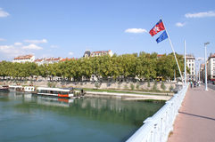 View of Rhone from a bridge, Lyon. A summer day in Lyon, France. The river Rhone flows through the city and its green hue can clearly be seen here, along with Stock Photo