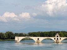 View on the Rhone river in Avignon, southern France. The river is crossed by a famous medieval bridge called the stock photo