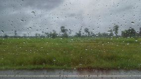 A view of rice field vintage from raindrop on the window. Raindrop and rice field Stock Image