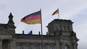 The German Bundestag building in Berlin with German flags stock photography