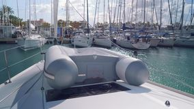 View of rigid inflatable boat on yacht board. In marina stock video footage