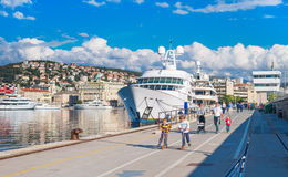 View of Rijeka port, kids ride scooters on the pier, Croatia, June of 2012 Stock Photography