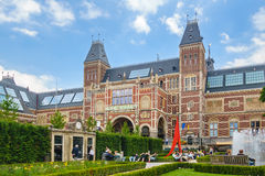 View at the Rijksmuseum with tourists sitting in the musem garde Royalty Free Stock Photo