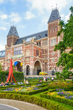 View at the Rijksmuseum with tourists sitting in the musem garde Royalty Free Stock Photos