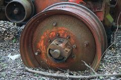 WHEEL RIM OF AN OLD RUSTED ABANDONED TRACTOR royalty free stock photo