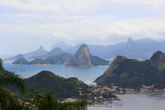 View of Rio de Janeiro from Niteroi, Brazil. Corcovado with Christ Redeemer and Sugarloaf in Rio de Janeiro from Niteroi during cloudy day, Brazil. Selective Stock Image