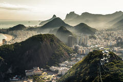 View of Rio de Janeiro From the Sugarloaf Mountain. View of misty Rio de Janeiro city by sunset from the Sugarloaf Mountain Royalty Free Stock Images