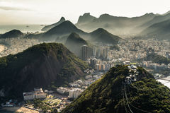 View of Rio de Janeiro From the Sugarloaf Mountain. View of misty Rio de Janeiro city by sunset from the Sugarloaf Mountain Stock Photo