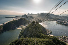 View of Rio de Janeiro From the Sugarloaf Mountain. View of misty Rio de Janeiro city by sunset from the Sugarloaf Mountain Royalty Free Stock Photos