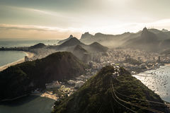 View of Rio de Janeiro From the Sugarloaf Mountain. View of misty Rio de Janeiro city by sunset from the Sugarloaf Mountain Stock Image