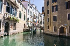 View of the Rio Marin Canal with boats and gondolas from the Ponte de la Bergami in Venice, Italy. Venice is a popular stock photo