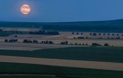 View of the rising moon over fields near reims in france.  royalty free stock photography